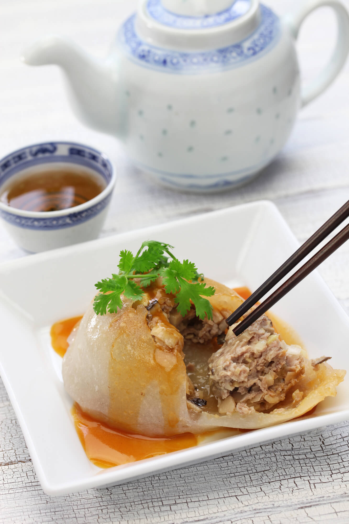 A large Ba-Wan, a tasty gelatinous Taiwanese dumpling that is both sweet and savoury.