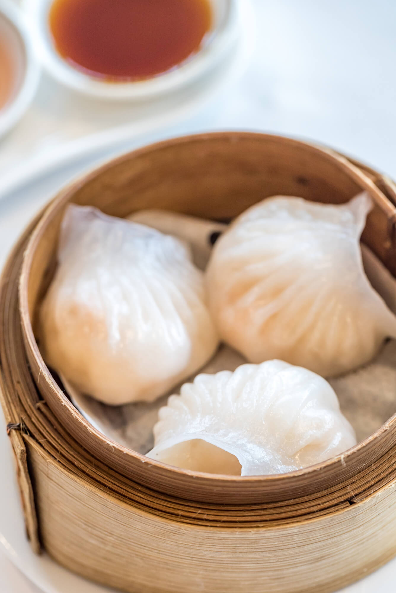 Har Gow Cantonese shrimp dumplings famous in dim sum, presented in a traditional bamboo steamer