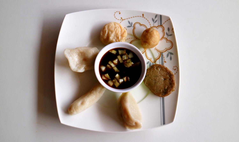 A plate of varied Pempek, delicious Indonesian fish dumplings