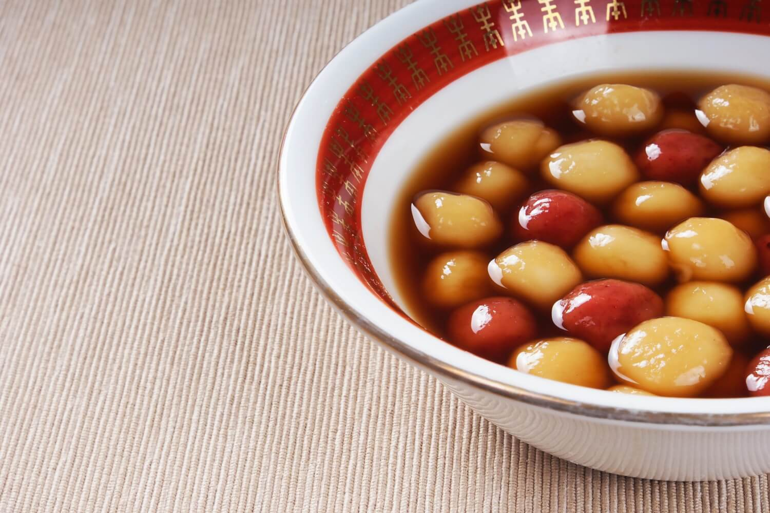 Tangyuan, tasty glutinous Chinese dessert balls that are commonly served in a sweet syrupy broth.